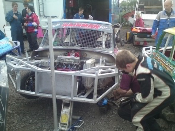Frankie JJ repairs his car.