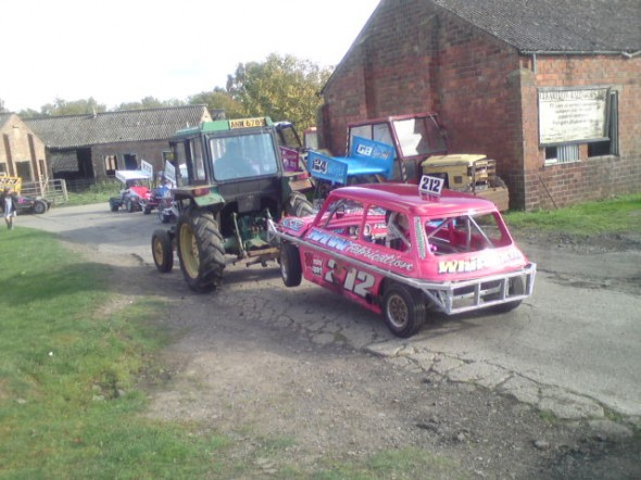 Phoebe towed off by her dad in a borrowed tractor.