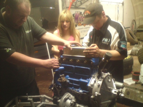 James, Phoebe, and Wez in the middle of the engine change.